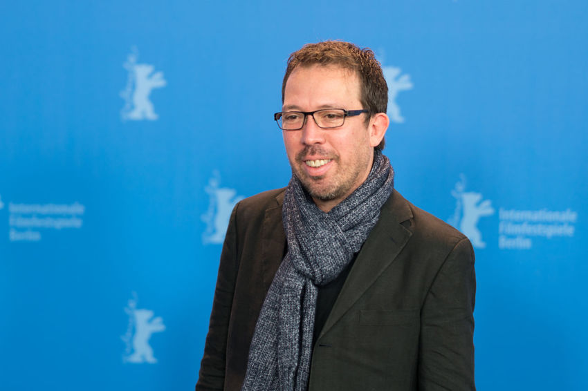 Berlin, Germany - February 16, 2018: Director and screenwriter Marcelo Martinessi poses before the press conference to present the film 'The Heiresses' (Las Herederas) during the 68th Berlinale Actor Fame Famous Film Festival Actress Adults Only Arts Arts Culture And Entertainment Berlinale Berlinale 2018 Berlinale2018 Cinema Entertainment Entertainment Event Eyeglasses  Film Industry Mature Adult One Man Only One Person People Portrait Press Conference Red Carpet Event Smiling Star