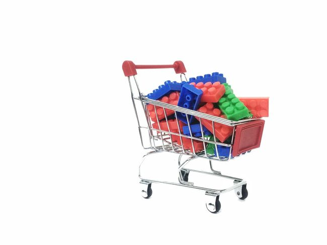 mini trolly with colorful building blocks. isolated white background Shopping Cart Consumerism Retail  Supermarket Buying Cut Out Customer  Shopping Bag Groceries Finance Shopping Basket Business Vegetable Merchandise Market E-commerce Studio Shot Food Fruit Stock Market And Exchange