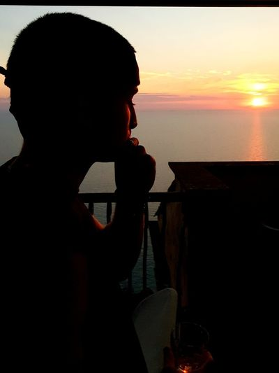 Relaxing Tranquility Thinking About Life Men Sea Water Sunset Standing Silhouette Sky Horizon Over Water Shining Sun Thinking Calm Evening Orange Color Looking At View