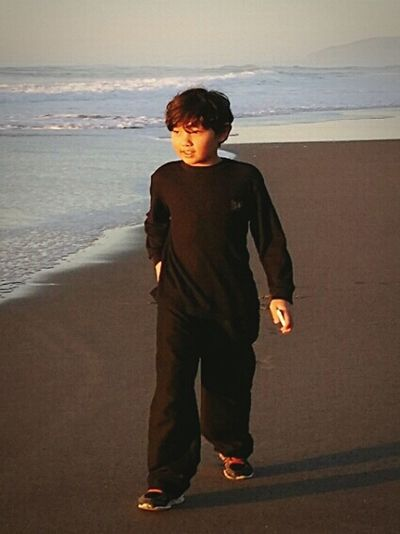 My Beautiful Son Walking On The Beach Into The Sunset Just The Two Of Us Hanging Out Loving Life  & Relaxing After A Long Day , Unwinding in the Pacific Northwest