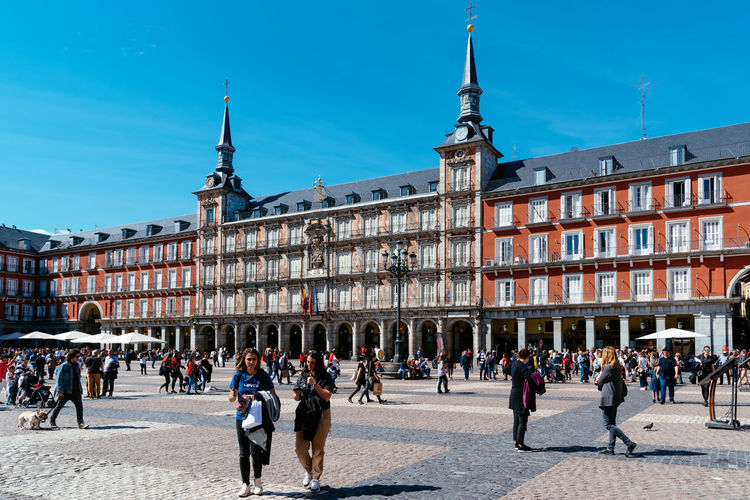 Plaza Mayor in historic center of Madrid Architecture Group Of People Built Structure Real People Men Building Exterior Crowd Day City Lifestyles Building Outdoors City Cityscape Madrid Travel Destinations Europe European  Sighseeing Tourism Plaza Mayor Square Arcade Travel