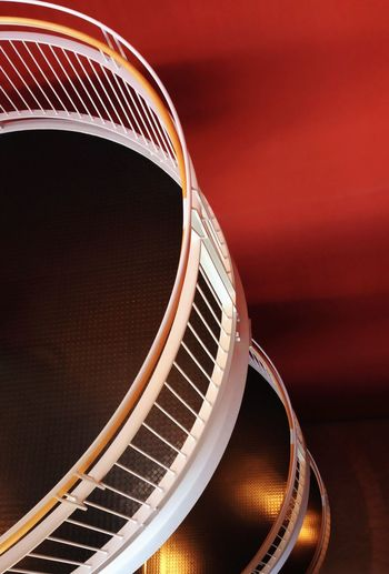 Looking Down Stairs Tiers Red Railing Architecture Abstract Eye Em Best Shots IPhone Photography Week On Eyeem No People Hand Rail Staircase Built Structure