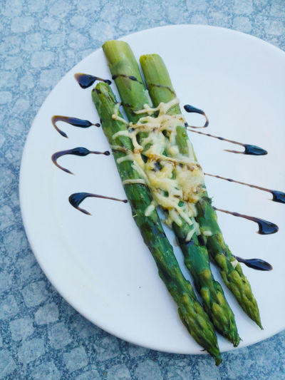 Declicious roasted green asparagus drizzled with balsamic vinegar, garnished with some shredded parmesan cheese, on a white plate. Asparagus Season Dinner Food And Drink From Above  Vegetarian Food Appetizer Asparagus Balsamic Vinegar Close-up Food Food And Drink Food Porn Healthy Eating Plate Ready-to-eat Restaurant Roasted Springtime Vegetable Vegetables Veggies