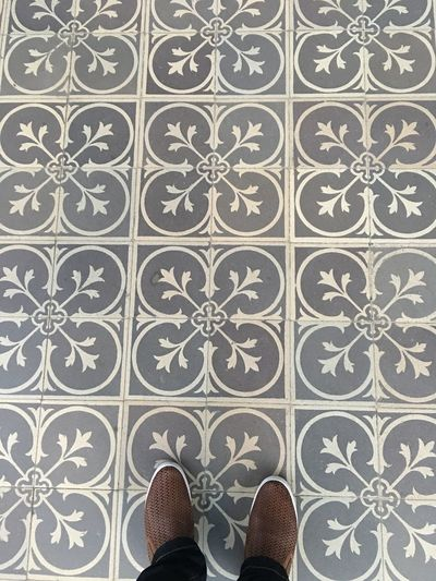 Low Section Of Man On Tiled Floor