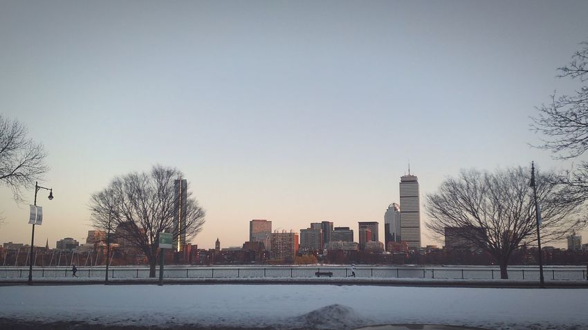 Beautiful View of a Downtown Boston as seen through Charles River in front of Mit during a Cold Winter Day. Cityscape Skyline