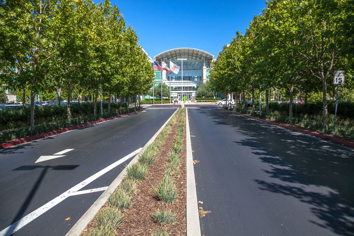 Cupertino, California, United States - August 15, 2016: the Apple world headquarters at One Infinite Loop. Apple is a multinational that produces consumer electronics, personal computers and software. people come from the popular Apple store of Apple Inc Headquarters at One Infinite Loop located in Cupertino, Silicon Valley, California. Apple California IT Mac PC United States Architecture Building Building Exterior Built Structure City Clear Sky Computer Cupertino Day Electronics Industry Flag Headquarter Headquarters Hq IMac27 IPhone Imac Infinite Loop Mobile No People Outdoors Road Sky Store Tree Water