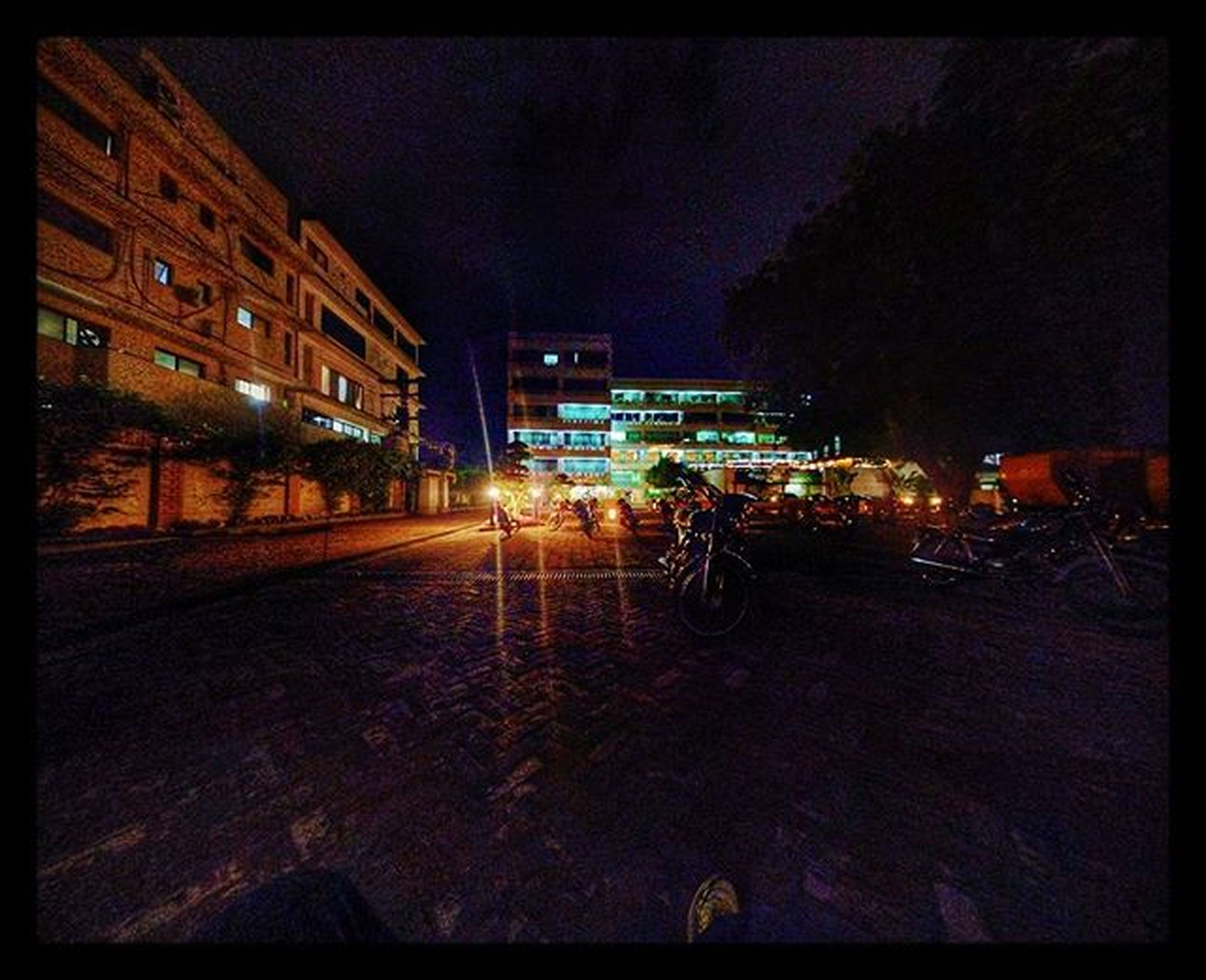 transfer print, building exterior, illuminated, night, architecture, built structure, auto post production filter, street, city, transportation, street light, sky, road, the way forward, car, building, residential structure, outdoors, residential building, land vehicle