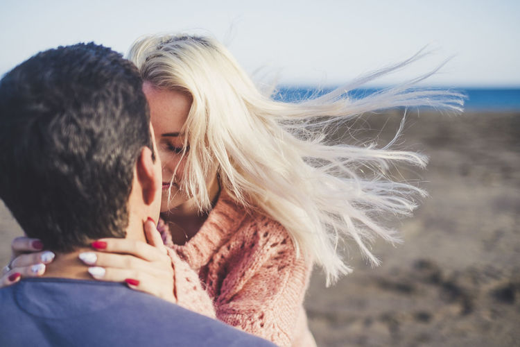 Close-up of young couple falling in love at beach