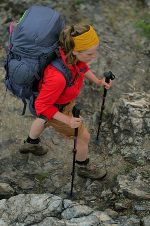 female hiker walking on a trail Alpine Backpacking Camping Expedition Freedom Hiking Nature Travel Trekking Woman Active Activity Adventure Backpack Boot Climbing Clothing Day Detail Female Females Full Length Hiking Hobbies Holding Legs Leisure Activity Lifestyles Nature One Person Outdoors People person Real People Rock Rock - Object Solid Trek Walking Women
