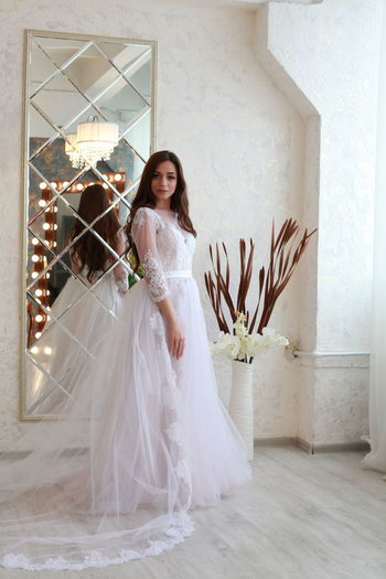 One Person Real People Full Length Young Women Women Portrait Young Adult Lifestyles Fashion White Color Clothing Indoors  Looking At Camera Standing Leisure Activity Wedding Dress Beautiful Woman Adult Smiling Flooring