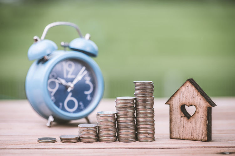 Finance Coin Wealth Alarm Clock Savings Number Focus On Foreground Business Metal Close-up Table Stack Investment No People Wood - Material Time Clock Still Life Currency Silver Colored Economy Clock Face Making Money