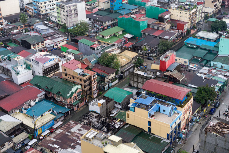 Manila residential area from high angle view Manila Philippines Top Aerial View Alley Apartment Architecture Building Building Exterior Built Structure City Cityscape Colorful Community Congested Crowd Crowded Day High Angle View House Makati Outdoors Residential District Roof Street The Architect - 2018 EyeEm Awards