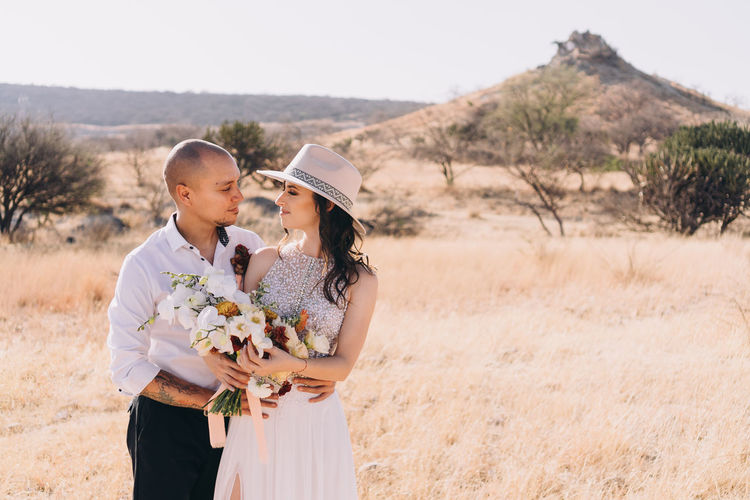 Side view of couple kissing on wedding day