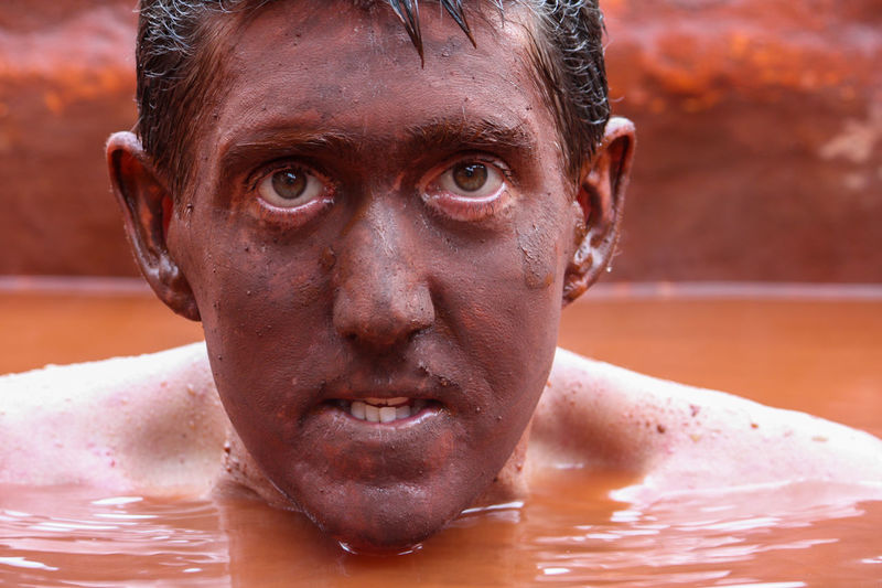 When in Ecuador...do as the Ecuadorians do and try the red mud bath BañosEcuador Connected By Travel Man Adult Close-up Day Ecuador Face Leisure Activity Lifestyles Looking At Camera Mud One Person Outdoors People Real People Red Mud Bath Spa Travel Destinations Water Wet
