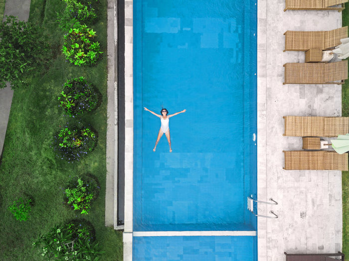 Full frame shot of swimming pool by window