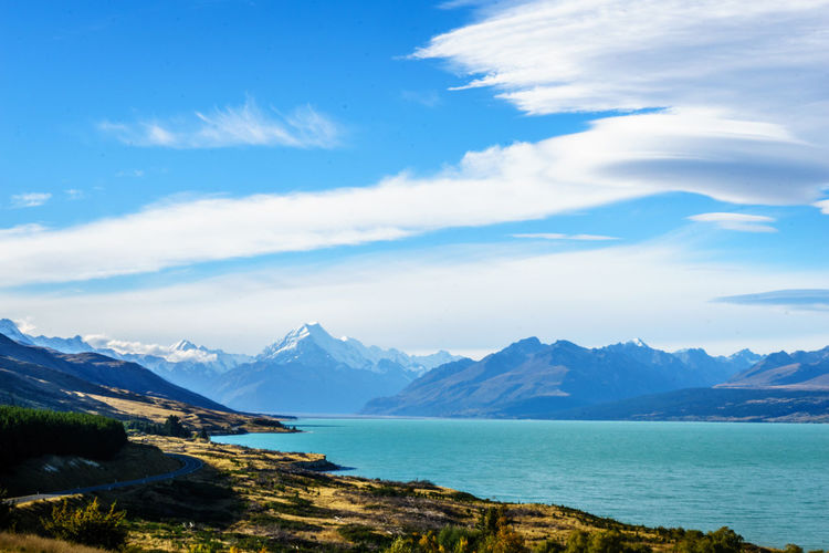Beauty In Nature Blue Cloud - Sky Day Idyllic Lake Landscape Mountain Mountain Peak Mountain Range Nature No People Non-urban Scene Outdoors Remote Scenics - Nature Sky Tranquil Scene Tranquility Water