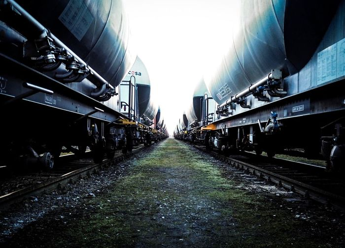 Freight trains against sky