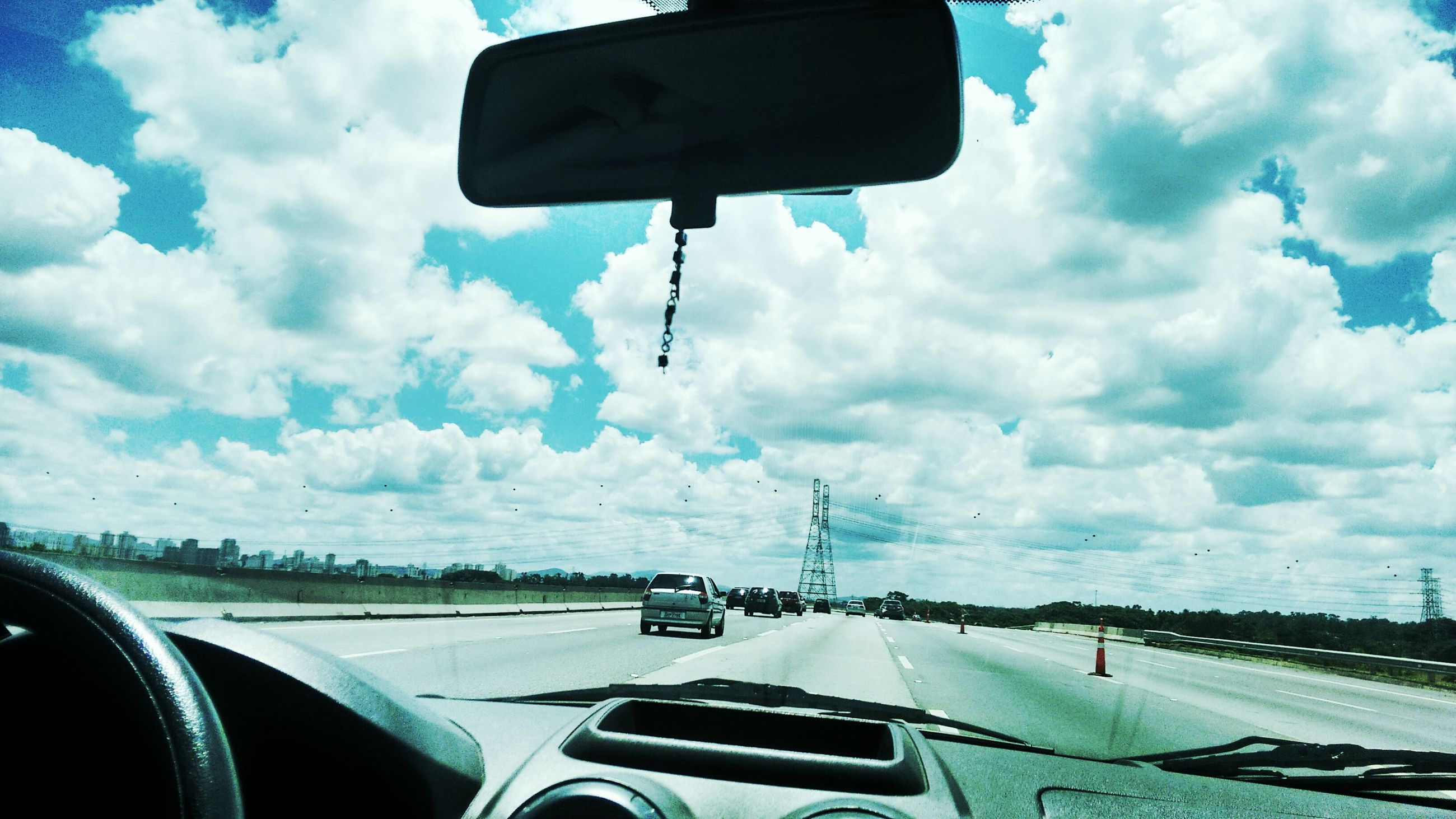 transportation, mode of transport, car, sky, vehicle interior, land vehicle, cloud - sky, airplane, travel, air vehicle, windshield, cloud, journey, part of, road, glass - material, vehicle part, car interior, transparent, on the move