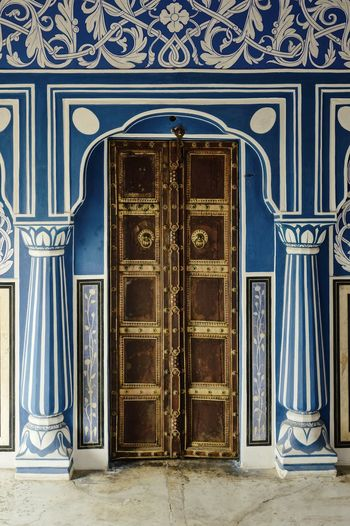 Blue Color Architecture Blue Building Building Exterior Built Structure Closed Day Design Door Doorway Entrance Floral Pattern Incredible India Luxury No People Ornate Palast Pattern Protection Safety Security Travel Destinations Wall - Building Feature Wood - Material