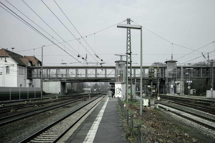 Railway Station Architecture Built Structure Cable Day Diminishing Perspective Outdoors Power Line  Power Supply Public Transportation Rail Transportation Railroad Station Railroad Track Railway Track Sky The Way Forward Train - Vehicle Tramway Vanishing Point