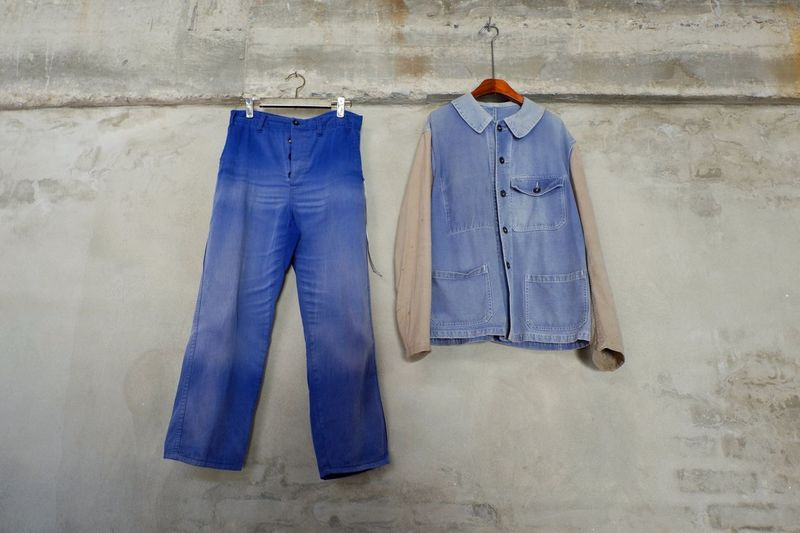 Isolated blue jeans and jacket on hanger on cement wall Shopping Trend Design Wardrobe Retro Rack Vintage Shirt Backgrounds Hanger Trousers Jacket Trendy Wall Clothes Bluejeans Jeans Hanging Blue Coathanger Clothing No People Fashion Indoors