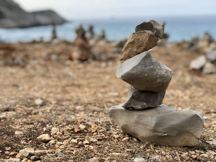 Rocks EyeEm Selects Land Focus On Foreground Beach Nature Day No People Close-up Sunlight Solid Balance Tranquility Stack Stone - Object Sand Field Art And Craft Outdoors Sky Creativity Landscape