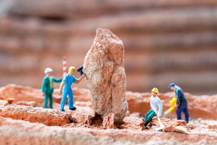 Close-up of figurine on rock