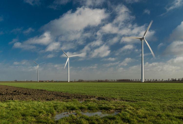Wind turbines in a row. Oranjedijk, Hoofdplaat EyeEm Market © EyeEm Premium Collection Renewable Energy Wind Turbine Alternative Energy Landscape Field Grass Cloud - Sky Action Shot  Sony A77ii Zeeuws Vlaanderen Zeeland  The Netherlands