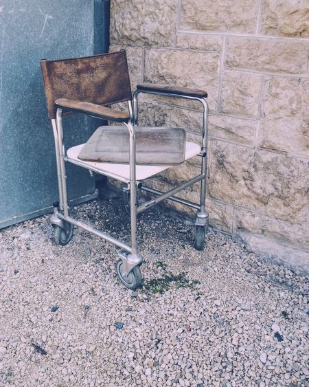 Antique Retro Old Abandoned & Derelict Wheelchair Unsettling Out With The Trash Discarded
