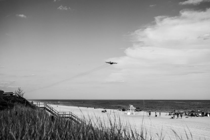 No-Fly Zone Beach Beauty In Nature Blackandwhite Photography Calm Cloud - Sky Coastline Day Fire Island Fujifilm_xseries Grass Horizon Over Water Idyllic Mode Of Transport Nature Non-urban Scene Ocean Outdoors Photographyisthemuse Plane Scenics Sea Shore Sky Tranquil Scene Water