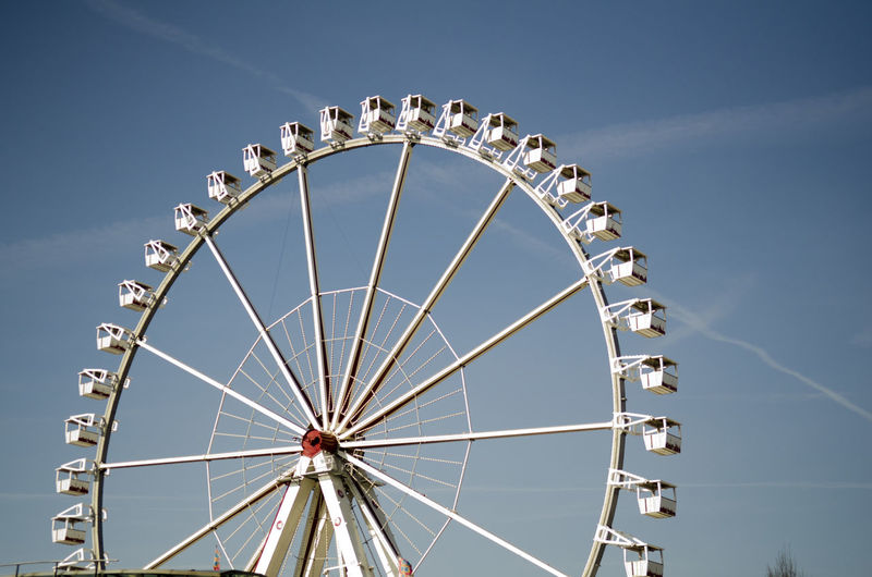 Amusement Park Amusement Park Ride Arts Culture And Entertainment Big Wheel Blue Circle Cloud Cloud - Sky Day Enjoyment Fairground Fairground Ride Ferris Wheel Fun Large Leisure Activity Low Angle View No People Outdoors Sky