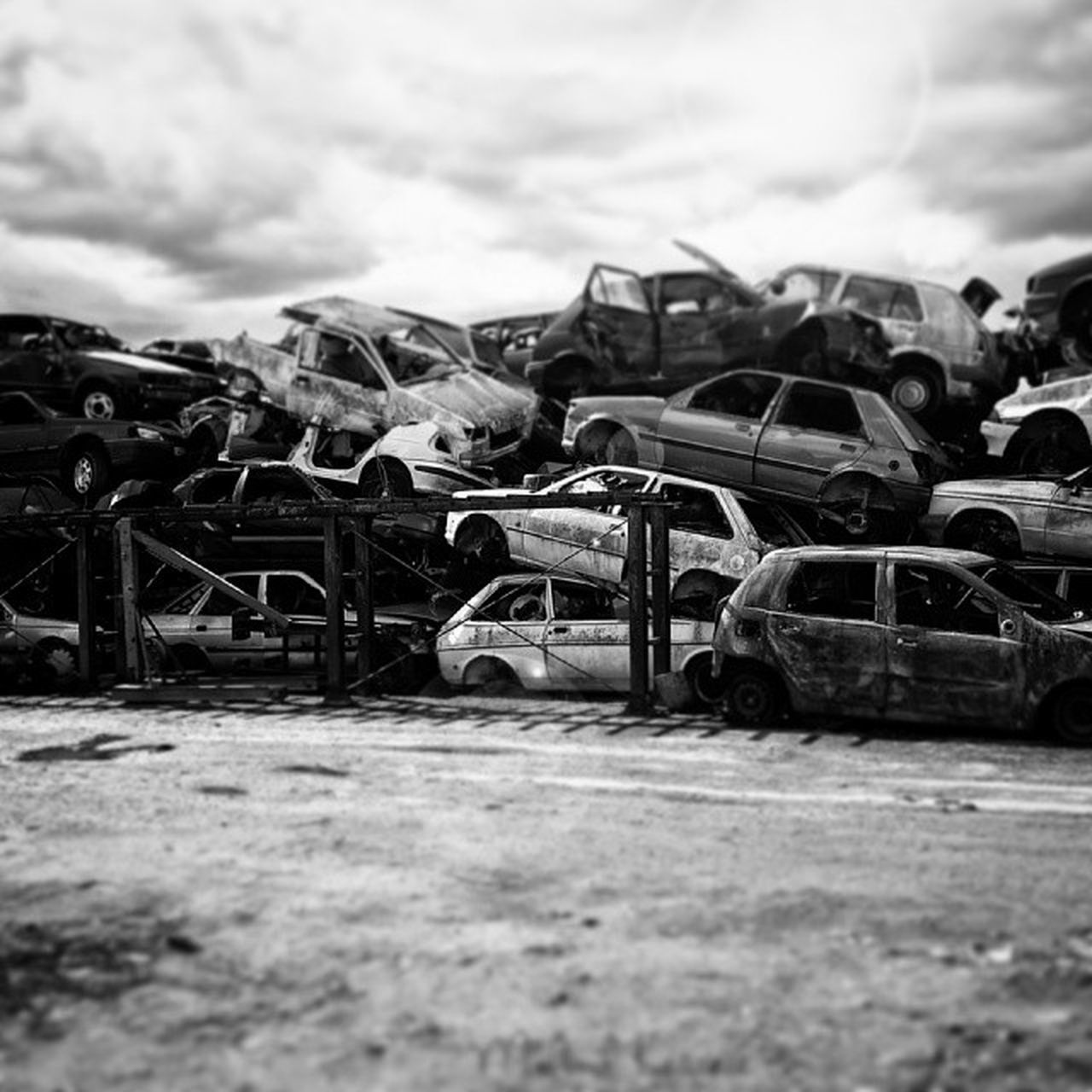 sky, transportation, selective focus, surface level, metal, focus on foreground, cloud - sky, outdoors, day, mode of transport, mountain, no people, in a row, close-up, cloud, road, abandoned, rusty, old, sunlight