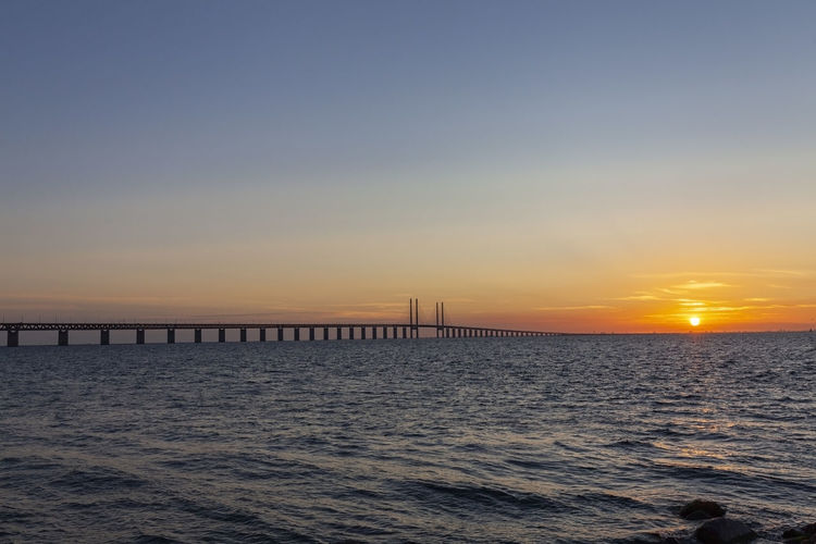 Öresund bridge at the evening with sunset Water Sky Sea Sunset Idyllic Outdoors öresund øresund Bridge Sweden Denmark Malmö