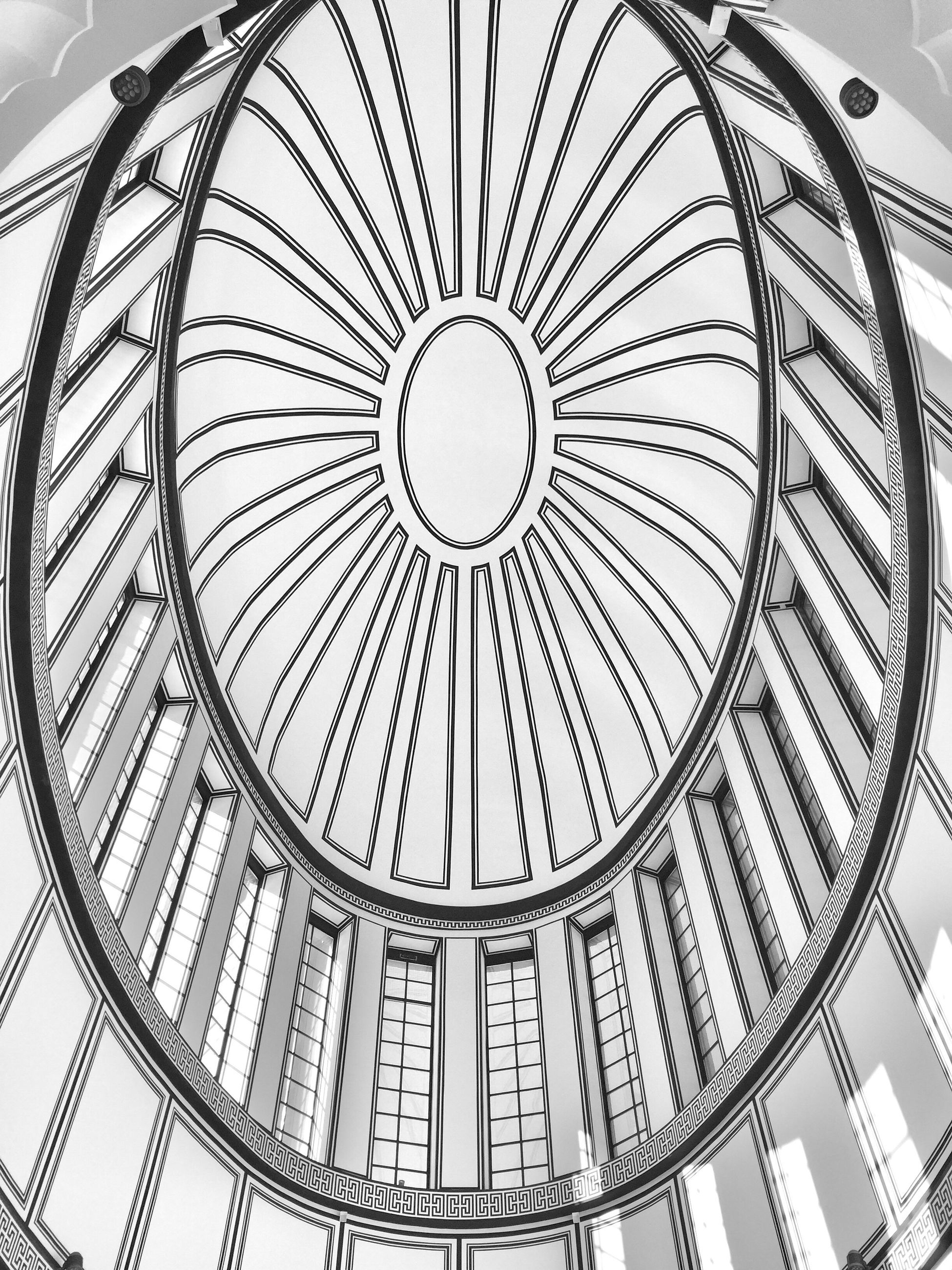 architecture, built structure, low angle view, ceiling, architectural feature, design, pattern, modern, indoors, geometric shape, directly below, repetition, day, architectural design, building story, skylight, sky, architecture and art, circle, national landmark, concentric, no people, city life, capital cities, architectural column