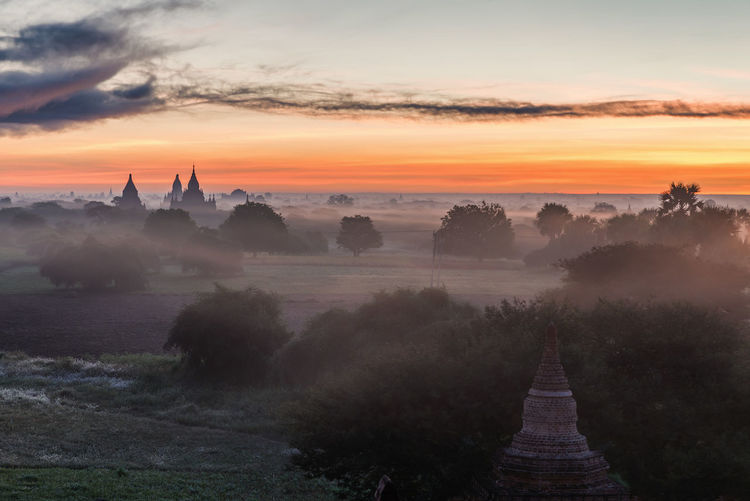 Bagan sunrise Sunset Sky Architecture Built Structure Cloud - Sky Building Exterior Scenics - Nature Beauty In Nature Orange Color Fog Nature Plant Place Of Worship Religion No People Tree Tranquil Scene Building Outdoors Travel Destinations Travel Myanmar Bagan Burma Architecture