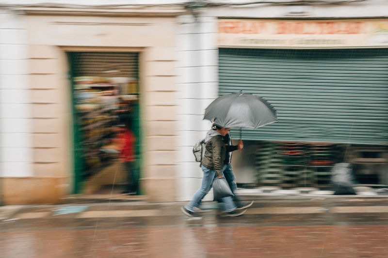 Rain Raining Rainy Days Rainy Season Rainy City City Bogotá Colombia South America Latin America Motion Full Length Blurred Motion Building Exterior Umbrella Architecture Built Structure One Person Walking Protection Day Real People Men Street Security Adult Outdoors