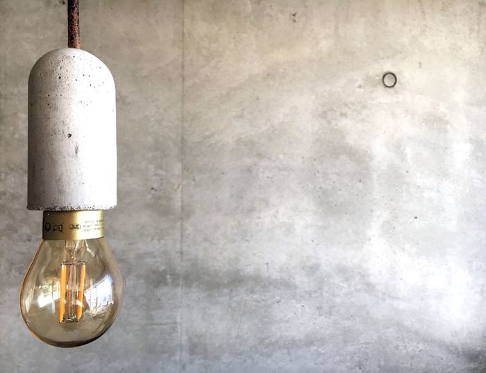 EyeEm Selects Photography EyeEmNewHere Wall - Building Feature Lighting Equipment No People Hanging Illuminated Indoors  Architecture Light Bulb Electricity  Concrete Single Object Light Technology