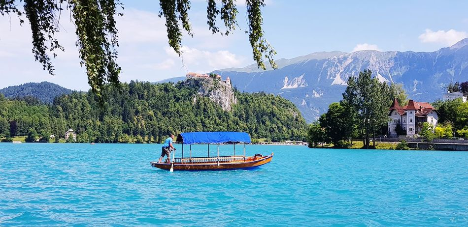 Bled lake, Slovenia #EyeEmNewHere #tourist Attraction #resort #travelling #beautiful #tourism #European#Destinations #castle  #Mountains #slovenia #landscape #nature #photography #Nature  #water #Lake #bled #travel Nautical Vessel Blue Boat Water Vehicle Sailing Boat Moving Sailing Visiting Lakeside Waterfront