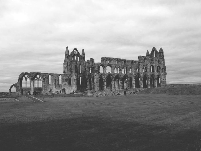 History Architecture Old Ruin Travel Destinations Built Structure Building Exterior Post Apocalyptic Architecture Light And Shadow Gothic Monochrome Photography Black & White Vacations Whitby Yorkshire Landscape Beauty In Nature Building No People Grass Horizontal Sky Outdoors Cultures Day