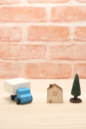 Hauler Automobile Copy Space Delivery Distribution Logistics Service Traffic Transportation Architecture Brick Brick Wall Built Structure Car Carry Copy Space Courier Drive Freight Miniature No People Pick Up Truck Toy Truck Vehicle