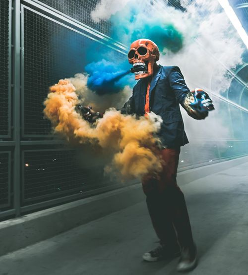 Anaklosangeles Smokebombphotography Skeletonart Skull Smoke - Physical Structure RISK Sunglasses Danger Full Length Real People Clown One Person Standing Holding Lifestyles Suit Architecture Building Exterior Outdoors Day Men Businessman Young Adult Adult
