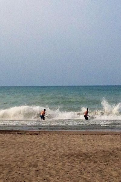 Sea Beach Wave Horizon Over Water Water Nature Shore Motion Sand My Sons Lake Michigan Home Of My Heart Listen Within Beautiful Day Scenics Beauty In Nature Skill  Men Day Two People Challenge Extreme Sports Outdoors Tadaa Community Tadaa Pocket_family