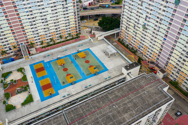 Aerial view of playground by buildings in city