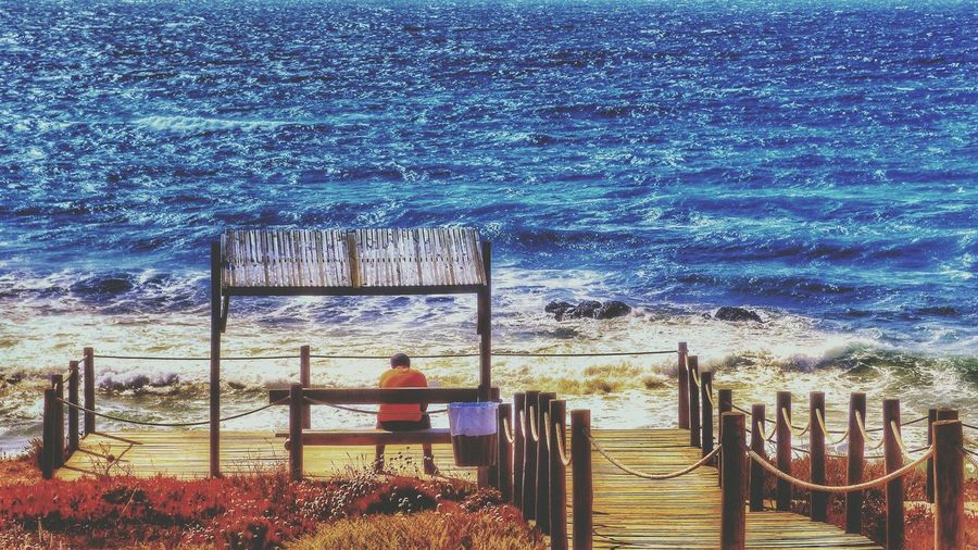 Water Beach Sky Sea Outdoors Nature Day Horizon Over Water Beauty In Nature Alone At Seaside Alone At Sea Sitting Alone Sitting View The Sea Sea_collection Man Man Sitting Alone Man Sitting Outside Seaside Wodden Pier Nature Collection Paint The Town Yellow The Week On EyeEm