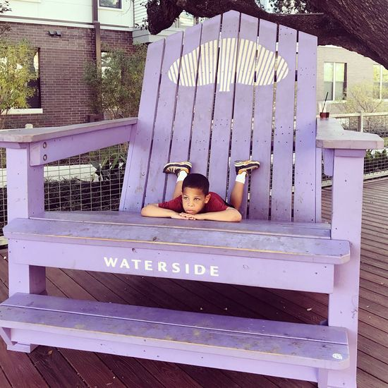 Giant purple tree and young boy Leisure Activity One Person Wood - Material Relaxation Day Real People Outdoors People Childhood Giant Purple Chair Relaxing Thinking Serenity Young Boy