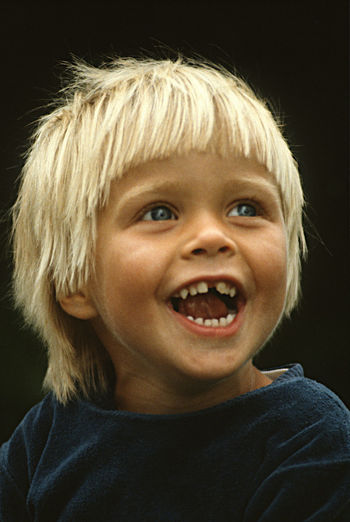 A Child Smiling A Three Yeas Old Boy Blond Hair Cheerful Close-up Happiness Headshot Joy Of Life Portrait Smiling