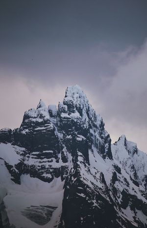Winter Snow Cold Temperature Sky Beauty In Nature Mountain Scenics - Nature Tranquil Scene Tranquility Mountain Range Snowcapped Mountain Cloud - Sky Nature Environment Mountain Peak Non-urban Scene No People Majestic Rock Formation