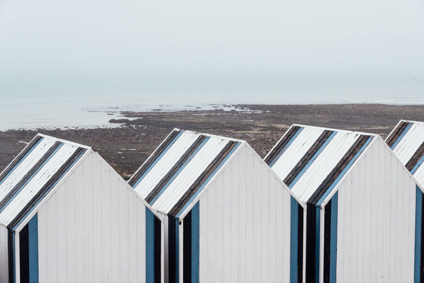 Beach Hut Hut Ocean Sea Seascape No People Day Landscape Beach Sky Water Architecture Nature Land Built Structure Horizon Wood - Material Building Exterior Side By Side In A Row Outdoors Horizon Over Water Wave Tide Shack Cabin Coastline Calm Coast Tranquil Scene