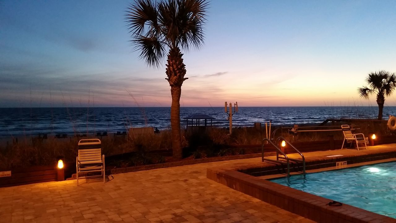 sea, water, horizon over water, scenics, palm tree, tranquility, tranquil scene, beauty in nature, beach, nature, sunset, sky, idyllic, vacations, tree, outdoors, swimming pool, no people, clear sky, day