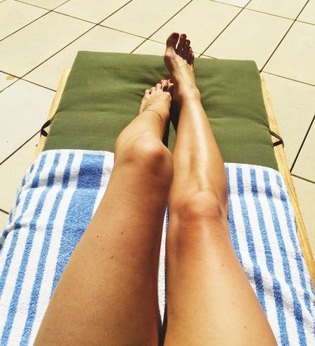 Poolside Low Section Person Person Personal Perspective Relaxation Barefoot Indoors  Bed Femininity Human Foot Beautiful Day Bare Human Skin Red Pool Time Relaxing Moments Relaxing Adulting Tanning Close-up Skin Legsselfie Legs And Feet